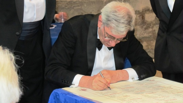 signing the Roll of Distinguished Philatelists in 2013